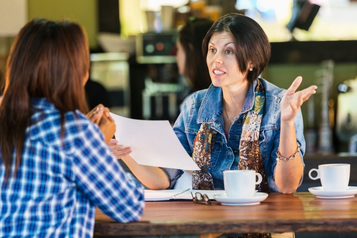 Women having business meeting or interview in local coffee shop